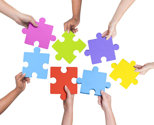 Human hands holding jigsaw puzzle..jpg
