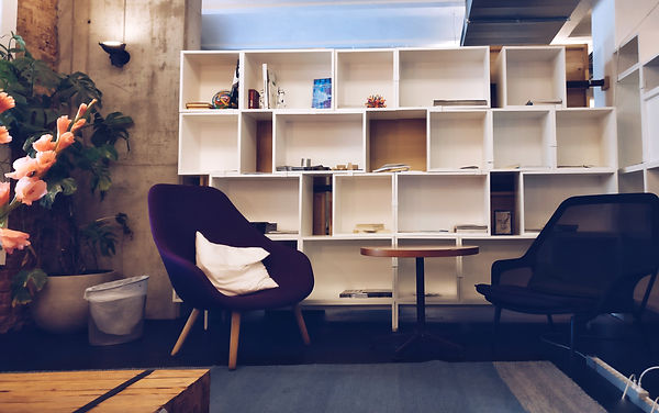 bookcase-bookshelves-chairs-609768.jpg