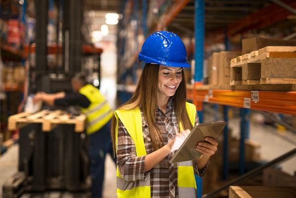 female-warehouse-worker-holding-tablet-c