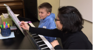 Piano Student and Piano Teacher