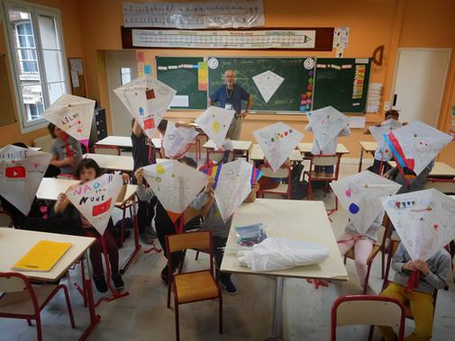 Children's kite-making activity at the International Dieppe Kite Festival, France