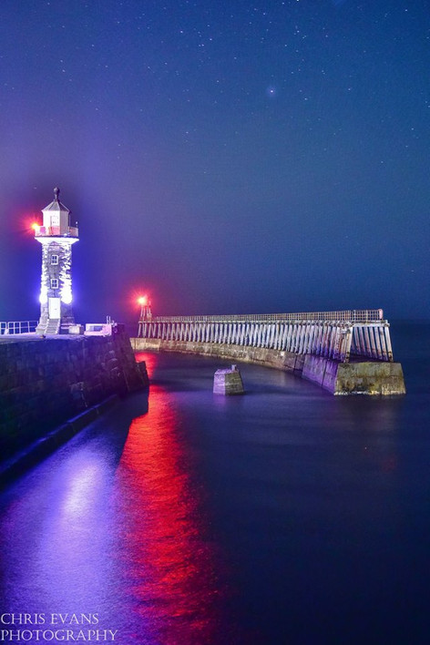 whitby east pier at night