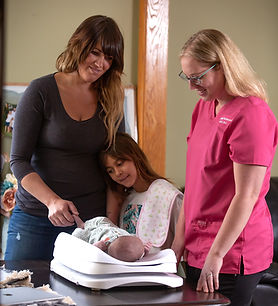 Lactation Consultant Weighing Baby