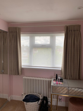 Under sill length pinch pleat curtains