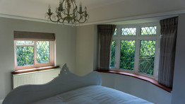 Double pinch pleat sill length curtains and roman blind