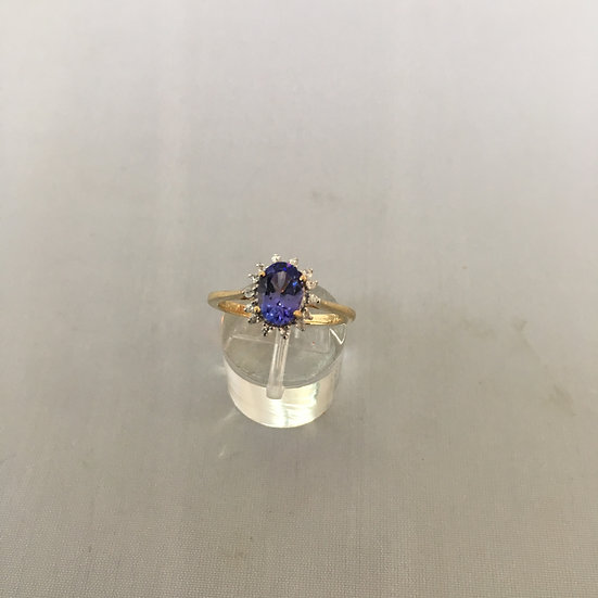 Oval Tanzanite Surrounded by Diamonds Yellow Gold Gemstone Ring