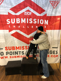 Harmony and I after her stripe promotion on the podium at submission challenge