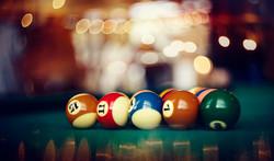 Colorful billiard balls on a green billi