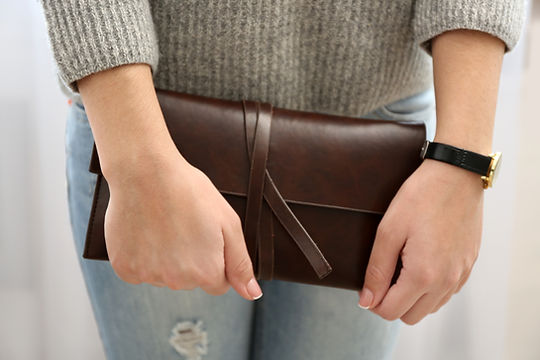 Girl with brown wallet