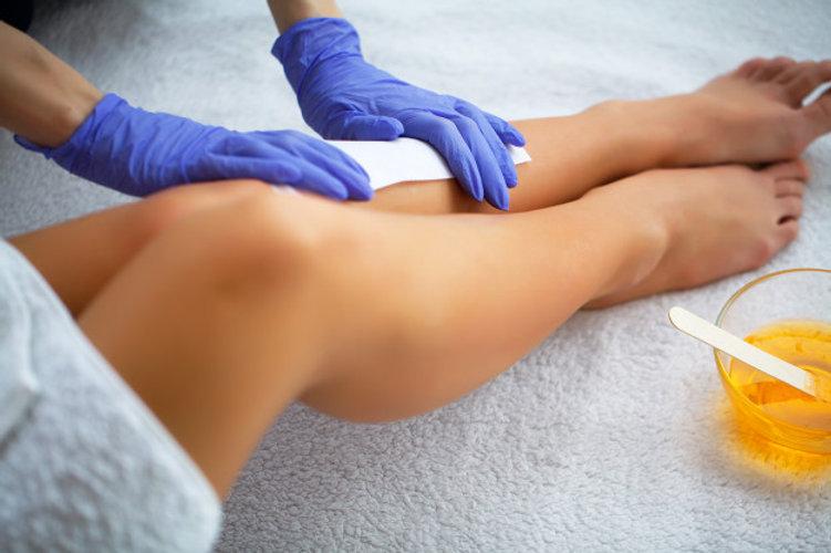 waxing-beautician-waxing-woman-s-leg-spa