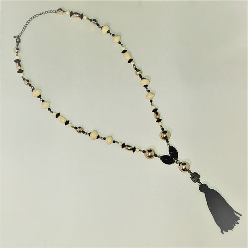 Black, white, copper tone bead necklace with tassel