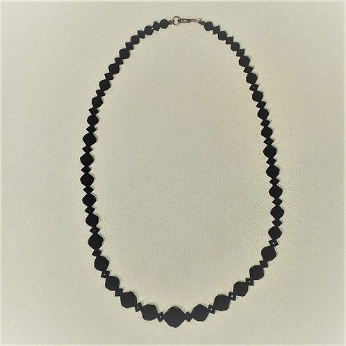 Black multi sized faceted bead necklace