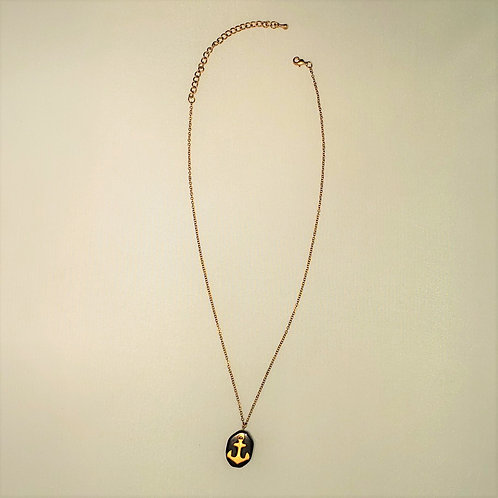 Black pendant with gold tone anchor
