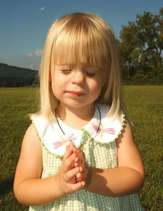 little girl praying compressed.jpg