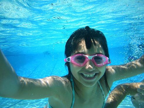 Girl enjoying swim time at summer camp