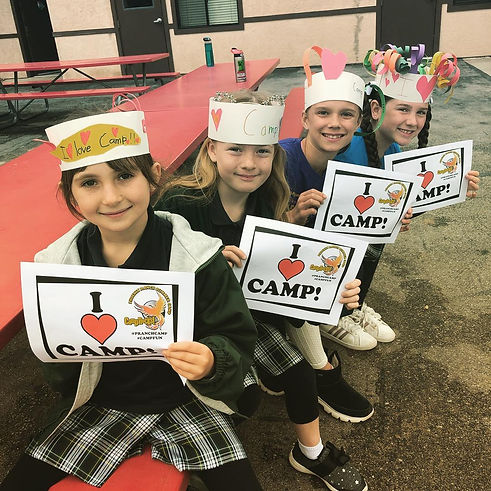 Phoniex Ranch students holding up I Love Camp signs