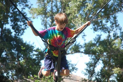 Child enjoying bungee jump