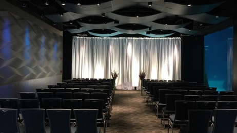 White fabric backdrop with uplights Adventure Aquarium Camden NJ.