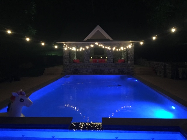 Bistro Lights Suspended over swimming pool Private Residence Malvern Pa.