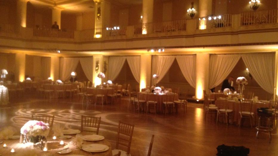 Uplighting, Pinspoting, Monogram on dancefloor, white drape between columns The Bellevue