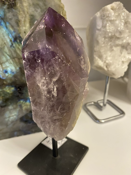 Amethyst point on black metal stand