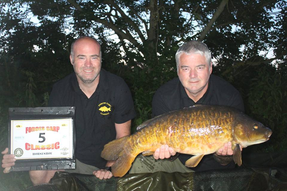 8.  Peg 5 and Ian with the first fish