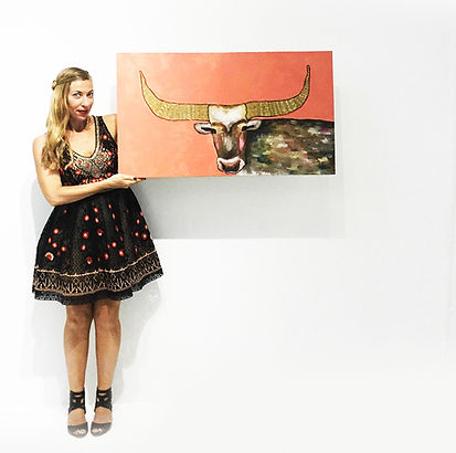 Eli holding Golden Bull copy.jpg