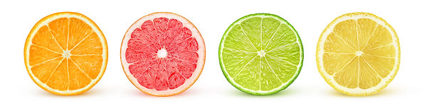 Isolated citrus slices. Fresh fruits cut