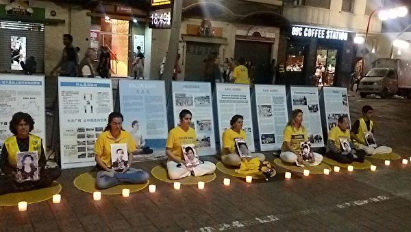 7月20日,部分巴西法轮功学员们在liberdade广场上烛光守夜,悼念在中国大陆被迫害致死的法轮功学员。(大纪元图片)