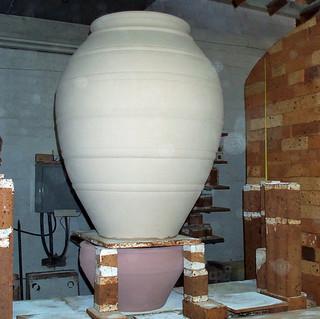 Raw-glazed pot on the kiln
