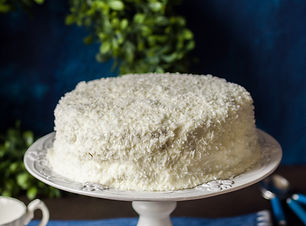 Cristmas Coconut Cake on a White Cake St
