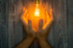 Hands-next-to-lit-light-bulb1.jpg