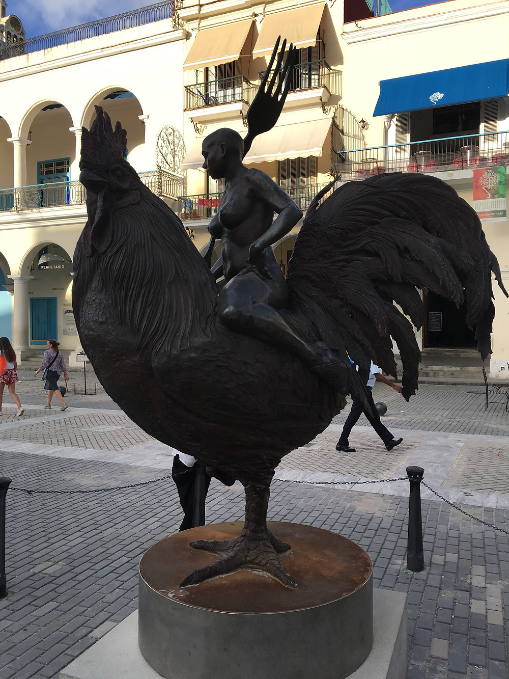 The Lady riding Rooster Statue