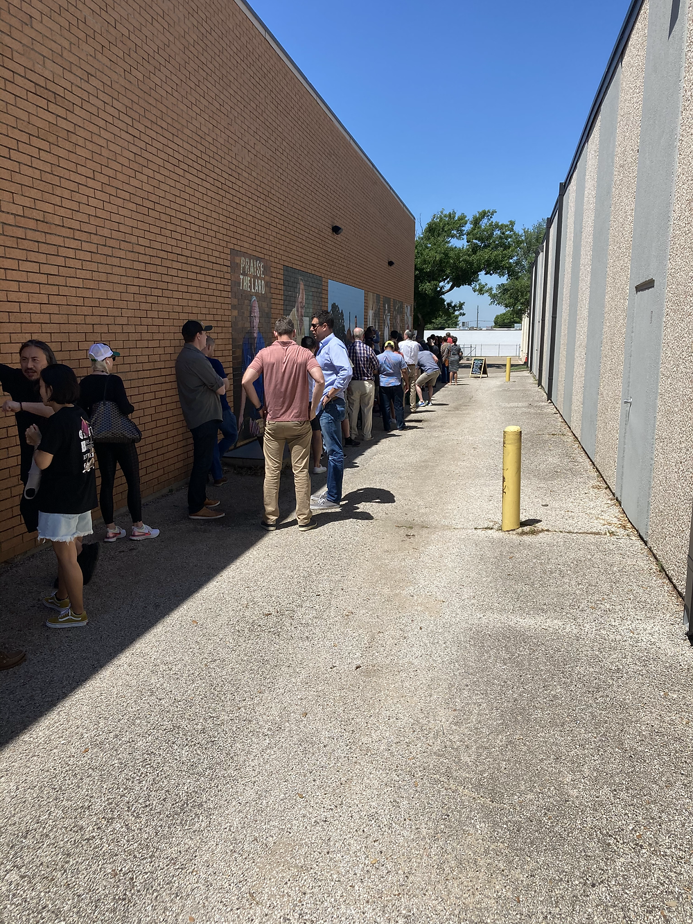 Cattleack BBQ line (wrapped around the store)