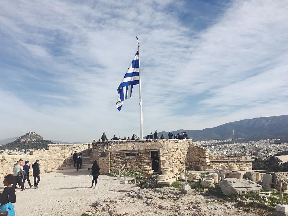The Greek flag soaring high above Acropolis