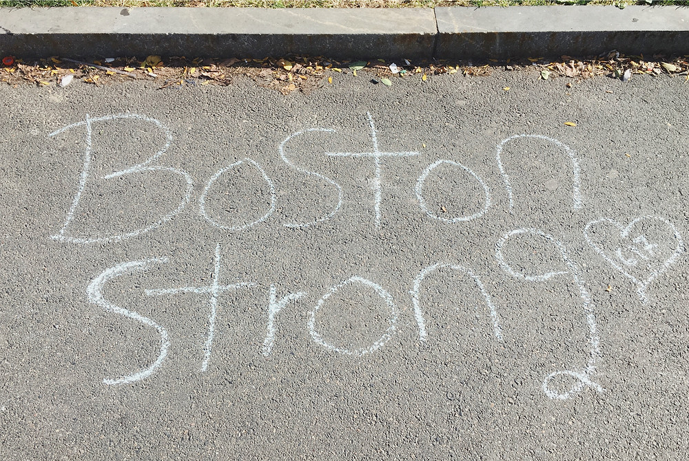 Boston Strong chalked in the pavement at Boston Commons