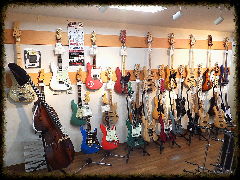 Selection of Atelier Z new and older guitar and bass models and the URB (Upright Bass)
