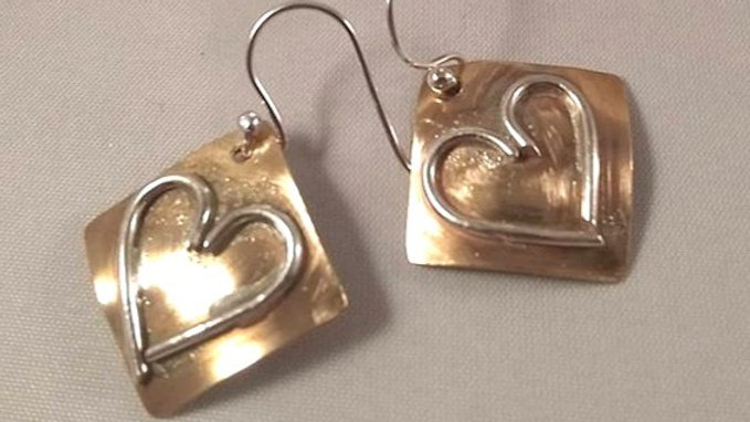 Silver Hearts on Bronze