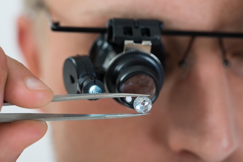 Jeweler Inspecting Diamond