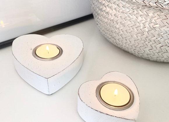 Set of white heart tea light holders