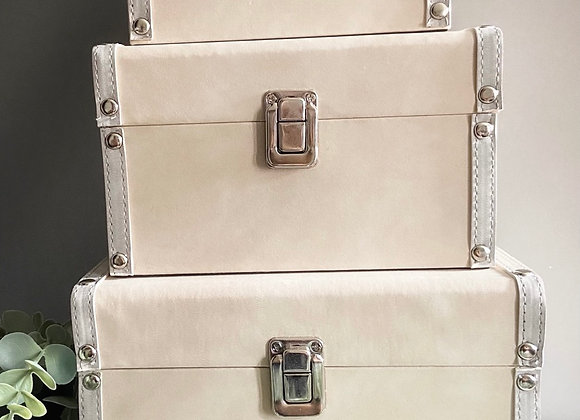Imperfect set of beige storage trunks