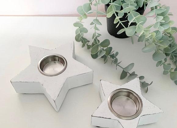Set of white star tea light holders
