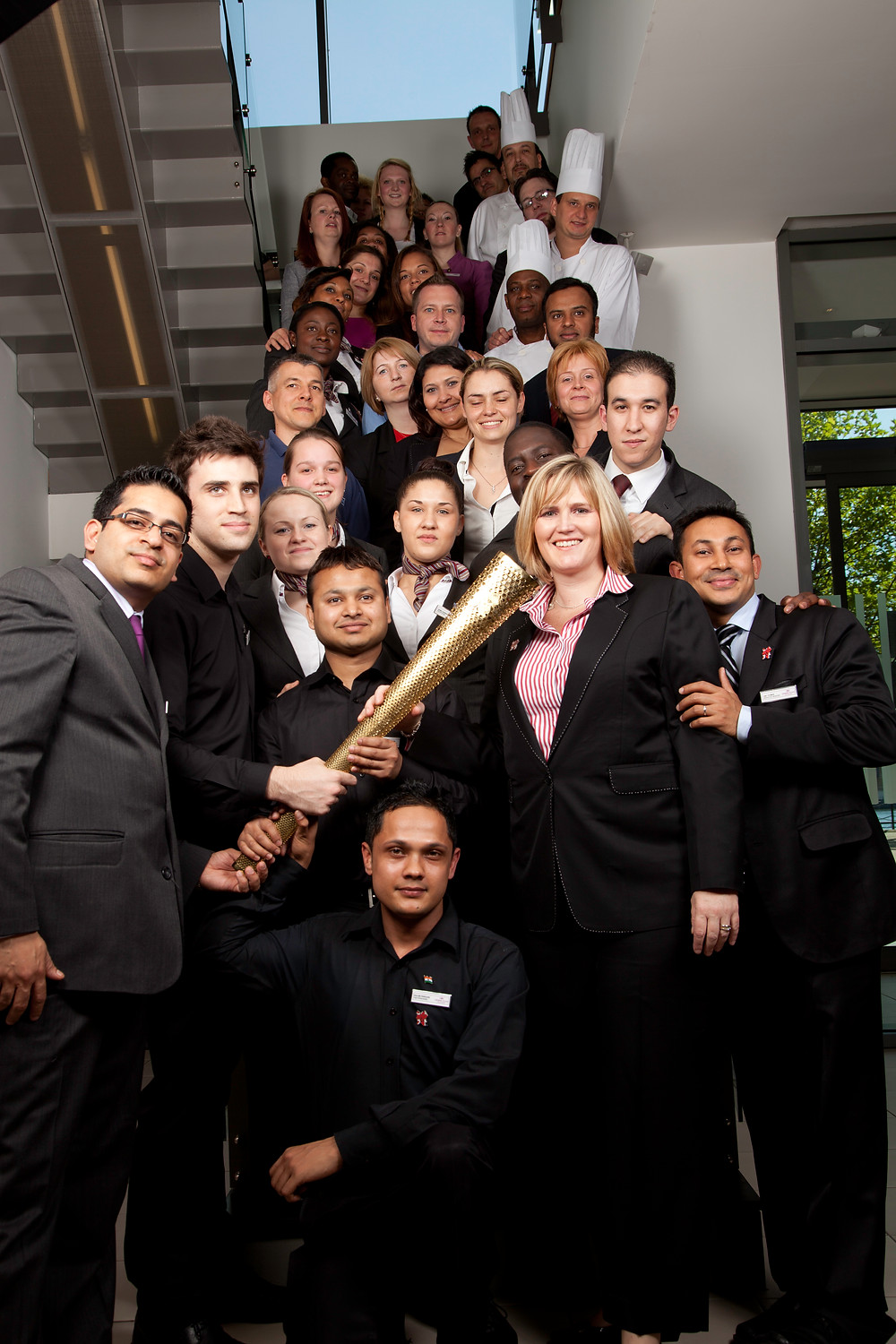 Joanne Taylor-Stagg and her team at the Crowne Plaza Docklands, 2012 with an Olympic torch.