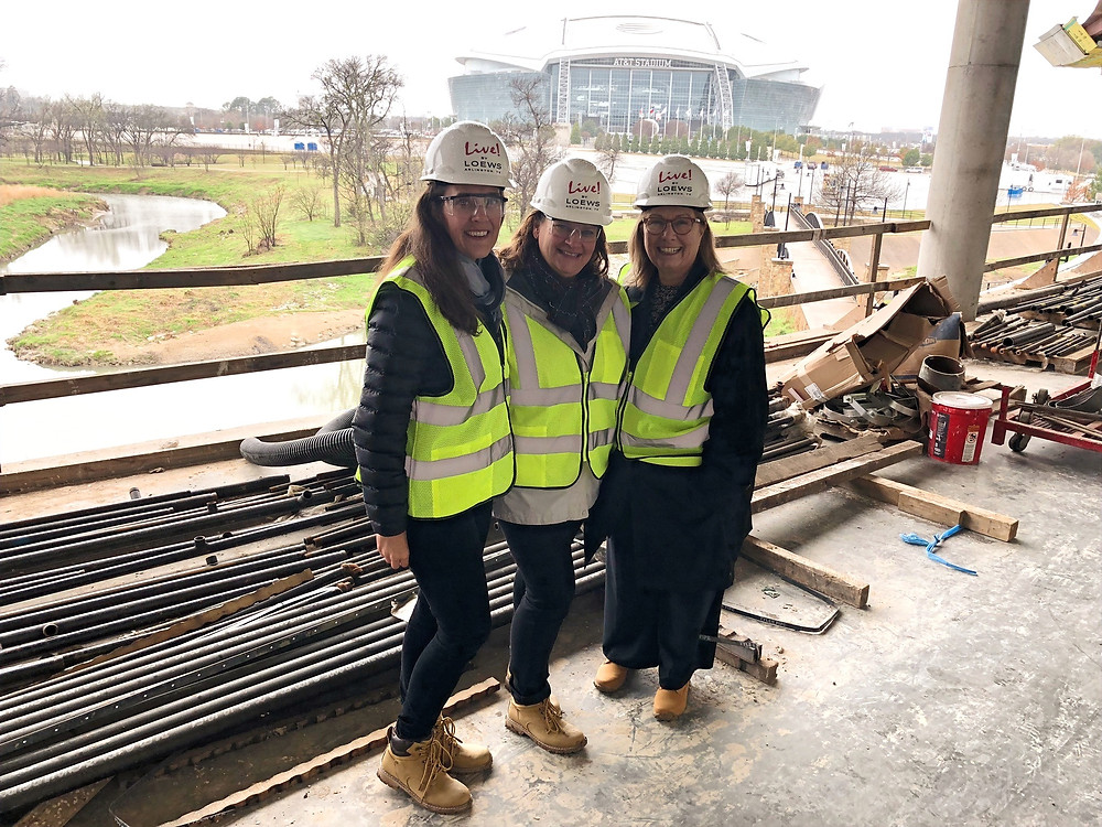 Three women at a Loews Hotels construction site