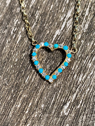 18ct Gold Turquoise and Diamond heart necklace hanging on a 20inchchain