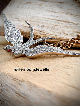 Victorian Silver and Old cut paste Swallow. Ruby Cabochon eyes. Hallmarked 900
