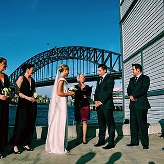 "Caroline and Zac say""I DO"" with Sydney's beautful Harbour Bridge as their backdrop!"