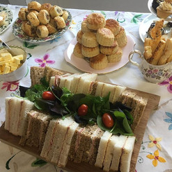 Sandwich selection with Sausage rollsm cheese straws, scones and cakes