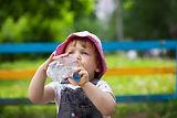 child-drinks-from-bottle_1398-1507.jpg