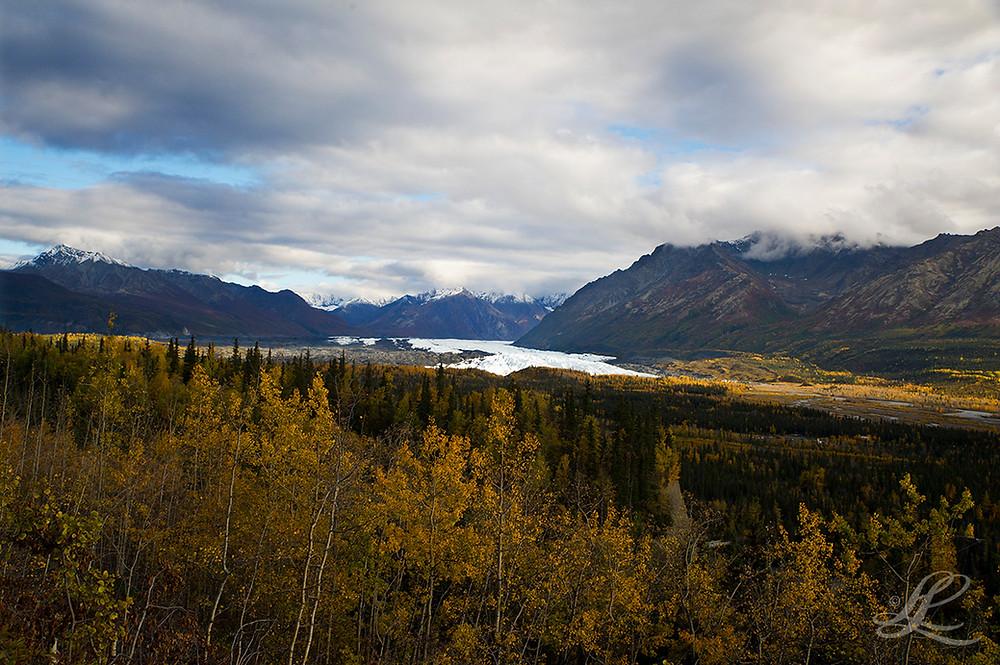 dramatic cloud formation above alaska landscape
